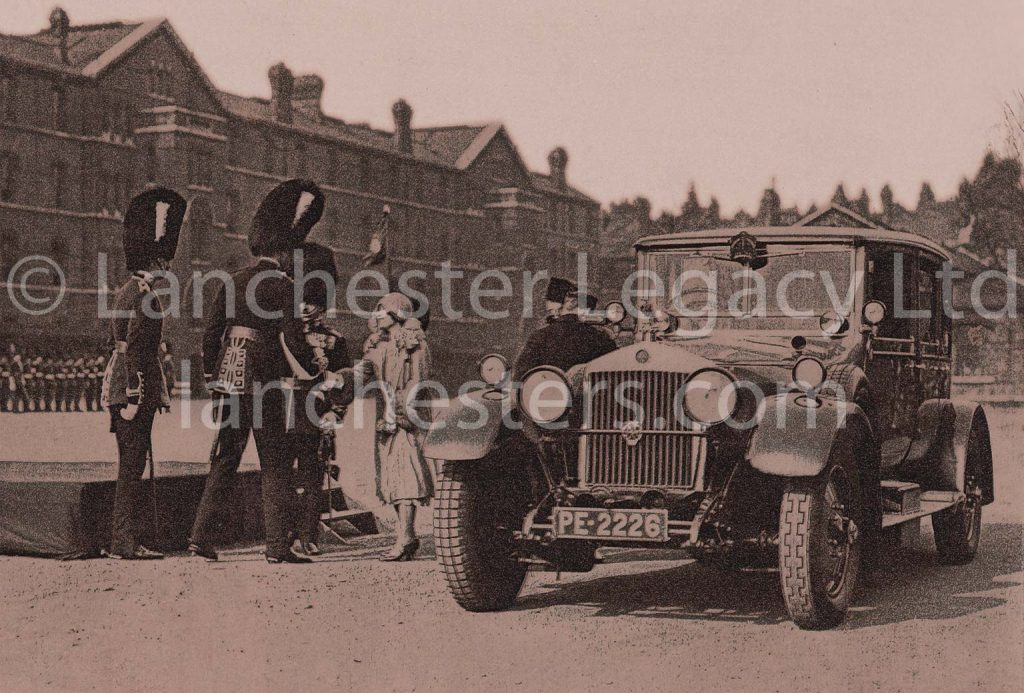 Duchess of York dwarfed by Irish Guards alongside Lanchester 40hp at Chelsea Barracks in March 1928